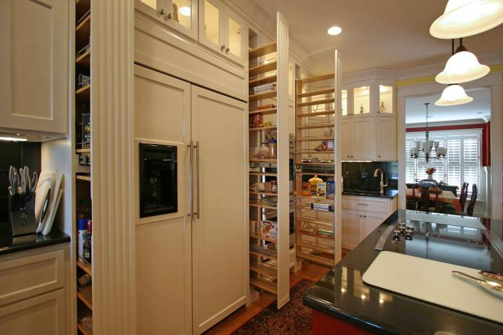storage pullouts,white cabinets,glass doors,prep sink,island,paneled coverd appliances