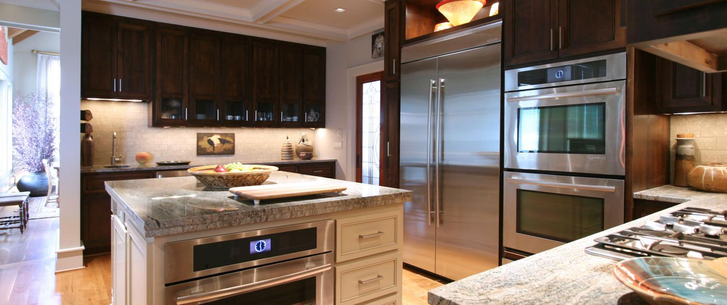 granite countertops,double oven,display shelf,kitchen,two toned cabinets