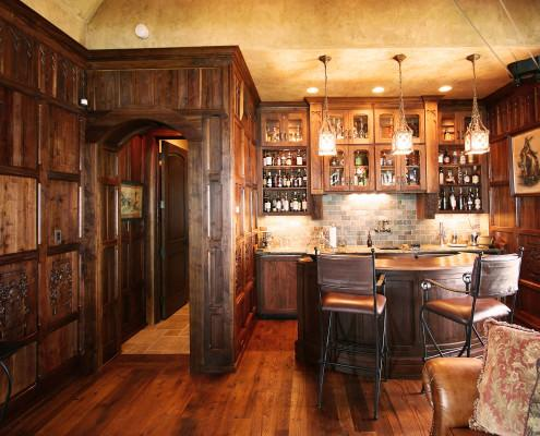 walnut stained wood,man cave,arched interior door,bar,open shelves