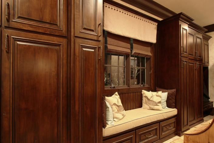 window seat, beadboard,mudroom ideas,stained cabinets
