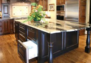 refrigerator drawer,hidden appliances,built in,kitchen ideas,black cabinets,storage island