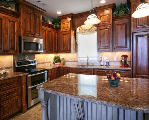 Rustic,Alder wood,granite countertop,beadboard,island,decorative posts