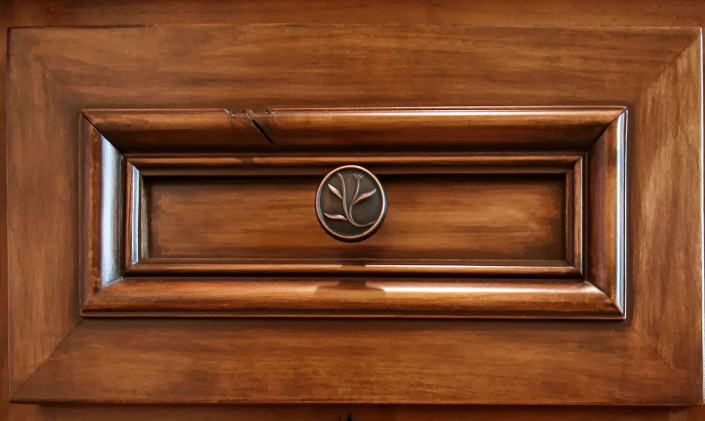natural distressed wood,applied molding,stained cabinets