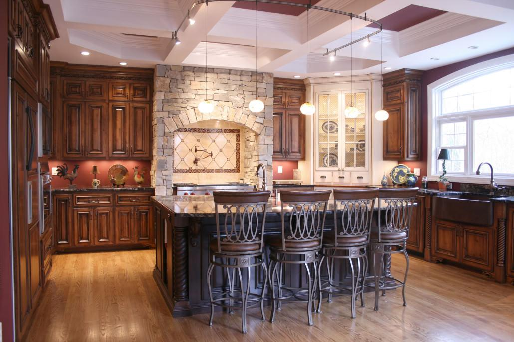 kitchen,island,three toned cabinets,display shelves,pot filler,seating area