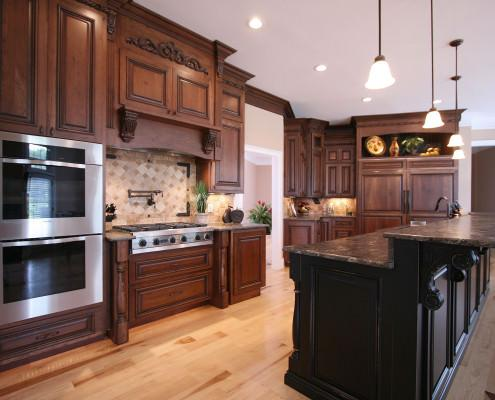 kitchen,island,paneled appliance,display,pot filler,tile back-splash