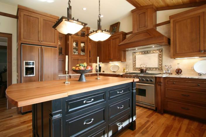 Craftsman kitchen,shaker style cabinets,custom bell style hood,black island,