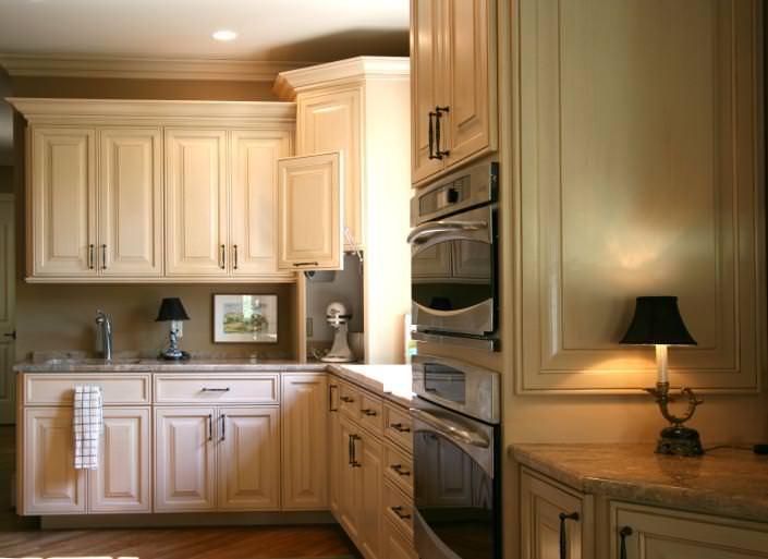 hidden storage,appliance garage,white kitchen,custom cabinets