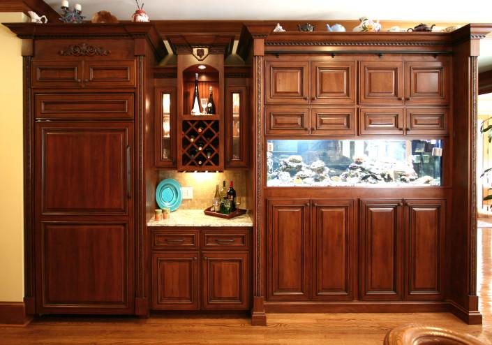 wine rack,cherry wood,decorative trim,crown molding,fish aquarium,