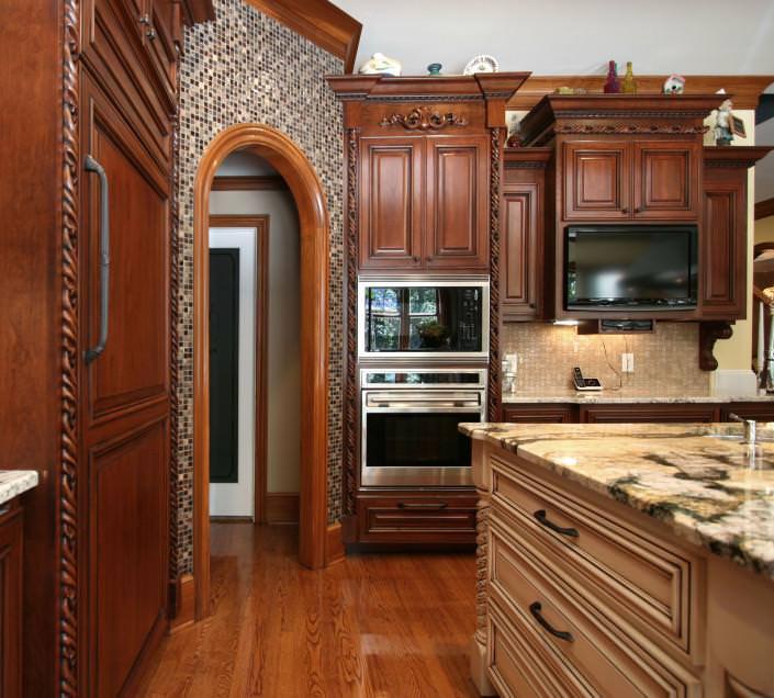 crown molding,arched interior door,volcano granite,glass tile,wood trim