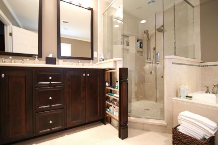 pull out drawer,glass shower,double vanity,wood framed mirror