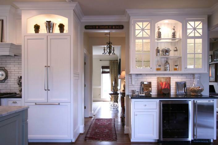 paneled appliance,wine refrigerator,open shelving,white kitchen,transitional style