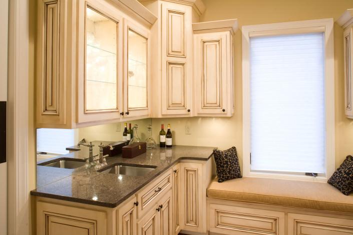 wet bar,bench seat,custom built,glass front cabinets