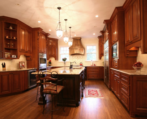 kitchen,island,copper hood,decorative details,two toned cabinets,traditional,ideas