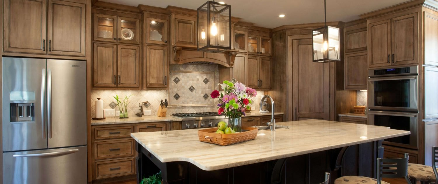 kitchen,island,two toned cabinets,decorative details,tile backsplash,hanging light fixtures,transitional