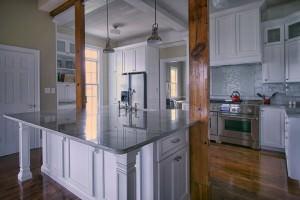 Farm house renovation, original beams, classic white cabinets