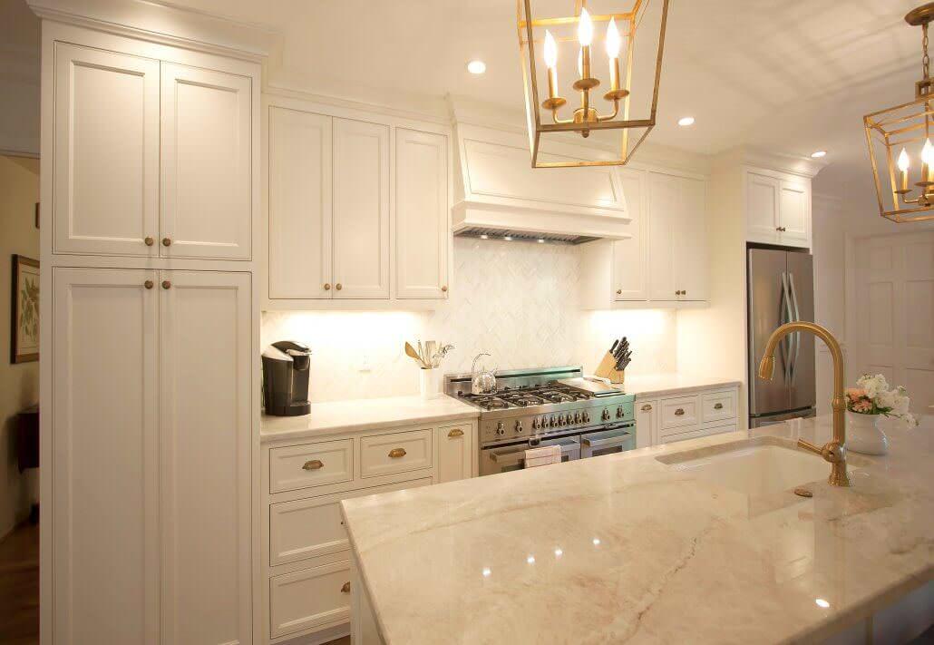 white-flat-panel-custom-cabinets-antique-brass-lights ...