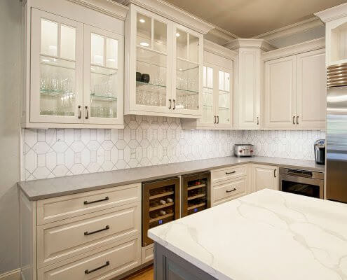 white cabinets, quartz counter-tops, marble backsplash