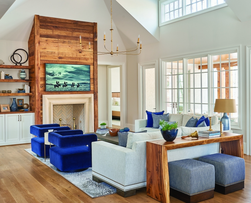 rustic family room, reclaimed wood fireplace mantel, floating wood shelves, white cabinets, vaulted ceiling