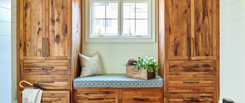 cerused white oak mudroom, white oak storage cabinets, wood bench seating, dark tile flooring, farmhouse mudroom