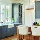 modern farmhouse kitchen cabinets, apron sink, reclaimed wood kitchen island, white stools, brass hardware